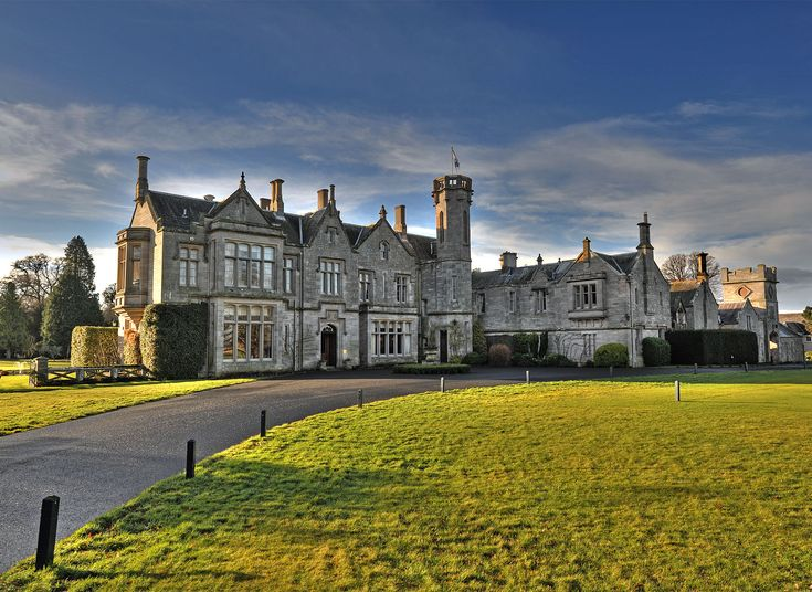 Roxburghe Hotel & Golf Course Heiton, United Kingdom Hotels grass sky tree landmark château building City castle cityscape rural area evening palace sunlight autumn monastery place of worship old Church grassy stone