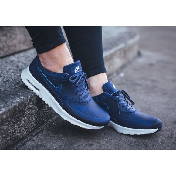 """Nike Air Max Thea Premium Leather Sneakers •The Nike Air Max Thea Women's Shoe is equipped with premium lightweight cushioning and a sleek, low-cut profile for lasting comfort and understated style. Color is """"Loyal Blue"""".  •Women's size 6.5, true to size.   •New in box   •NO TRADES/PAYPAL/MERC/HOLDS/NONSENSE. Nike Shoes Sneakers"""