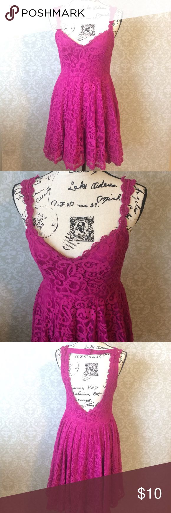 Pink dress Magenta dress with lace overlay. Has open back and zips up with clasp. Worn once. Great condition! Dresses Midi