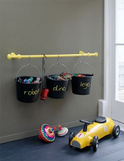 curtain rod and buckets for toy storage