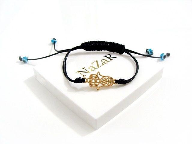 #sapphiresoul Gold Hamsa Bracelet with Evil Eye Beads - Hamsa Jewelry - Hamsa Hand bracelet - Braided Hamsa bracelet arrives in a white gift box! by EvilEyeGift on Etsy https://www.etsy.com/listing/191220714/gold-hamsa-bracelet-with-evil-eye-beads