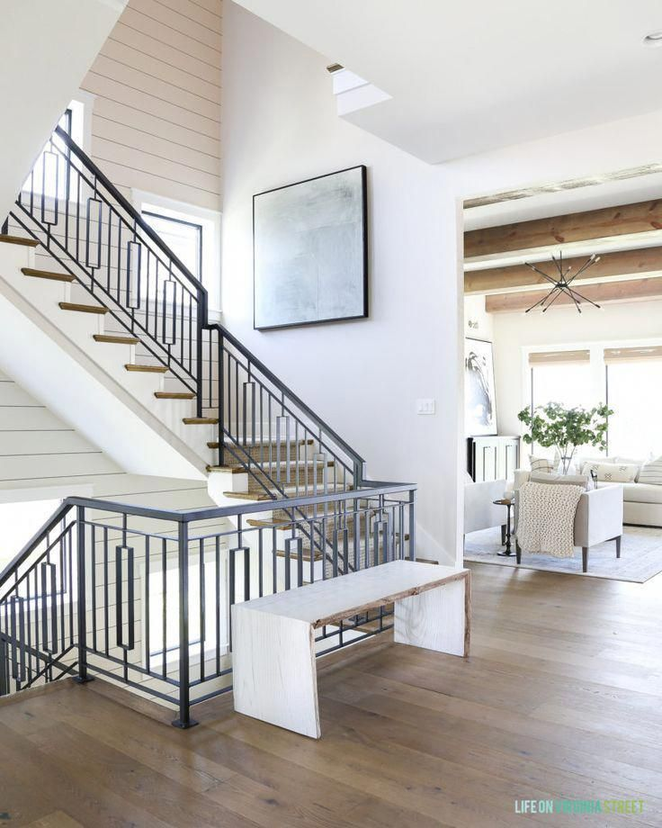 Metal staircase with a shiplap stair well and oversized abstract