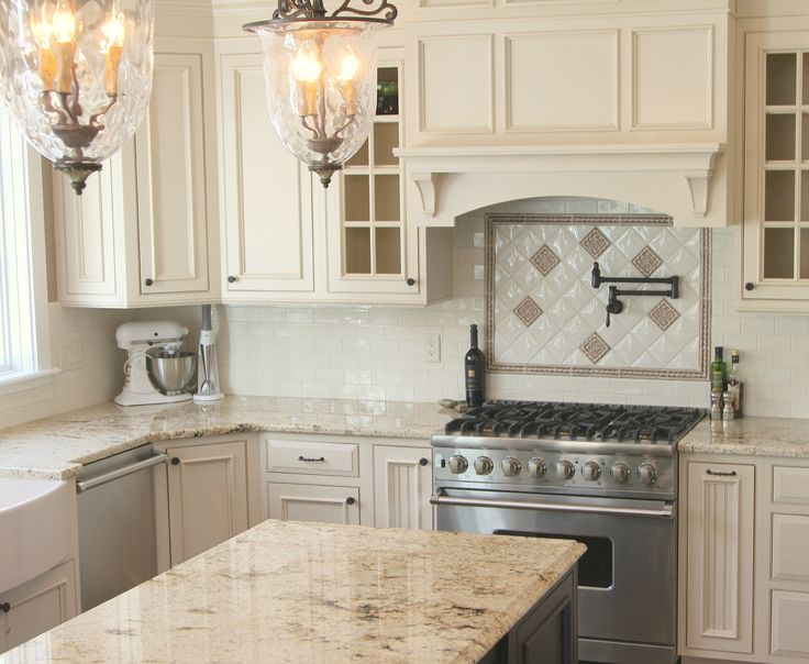 Creams and chocolates melt together, making for a truly delectable design in this kitchen. The soft cabinet doors are accented with a mocha glaze and dark, bold hardware. Studio by FINE 2.5x5 subway tile hug the perimeter of the space while the Senio Heos decos and borders in Beige dress to impress above the cooktop. Tying it all together... Sienna Creme granite countertops featuring coffee and caramel veins. Yum!  http://www.galleriastone.com/inspiredspaces/kitchen-cravings/
