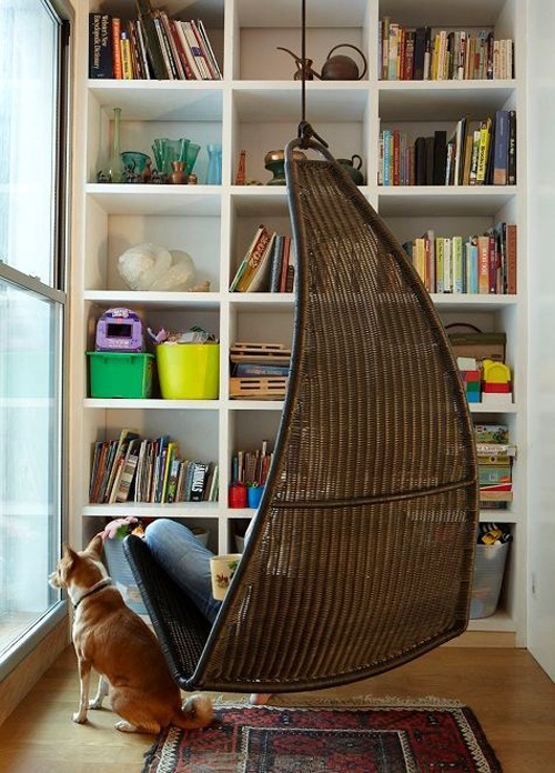 My daughter has this hanging chair in her room, but in white. Her hanging chair is also next to her bookshelf. I love this photo because it reminds me of her.