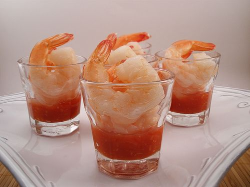 Shrimp in a shot glass with homemade cocktail sauce.  Can be prepared ahead of time.