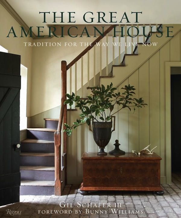 FARMHOUSE – INTERIOR – vintage early american farmhouse showcases raised panel walls, barn wood floor, exposed beamed ceiling, and a simple style for moulding and trim, like in this farmhouse book by gil schafer, the great american house.