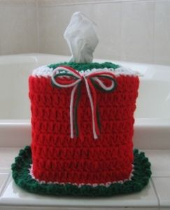 Crochet a Christmas Tissue Cozy to brighten up your powder rooms this Christmas!  This Christmas tissue box holder is made in a super simple pattern of the most basic crochet stitches, so making these red and green cozies will be quick and fun!