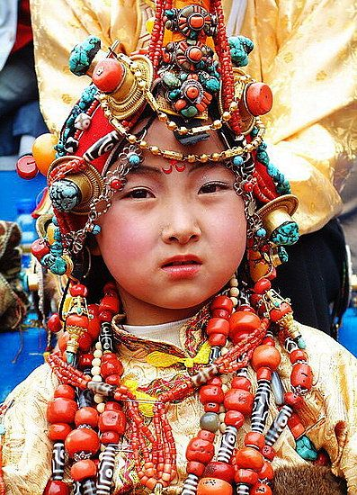 More pictures of traditional costumes and headdresses of Khampa Tibetans. These costumes are the most prized possessions of the wearers' families