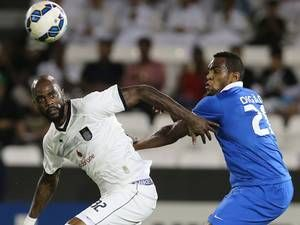 4 March 2015: Digao Silva (R) of Saudi Arabia's Al Hilal fights for the ball with Grafite of Qatar's Al-Sadd during their AFC Champions League soccer match at Sheikh Jassim Bin Hamad Stadium in Doha