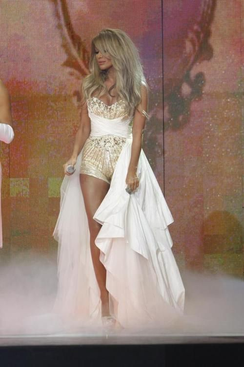 maya diab arabic tv host and singer. love this gold and white dress