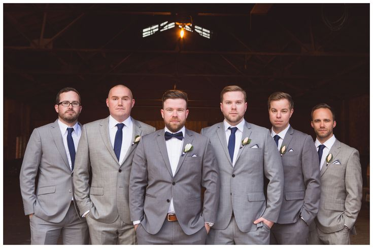 Mismatched groomsmen | Grey suits | Navy ties | Bow tie | Peach tulip boutonnieres | Wedding photography