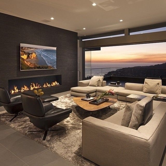 This is my idea of a great room. Fireplace type/wall texture/TV placement.