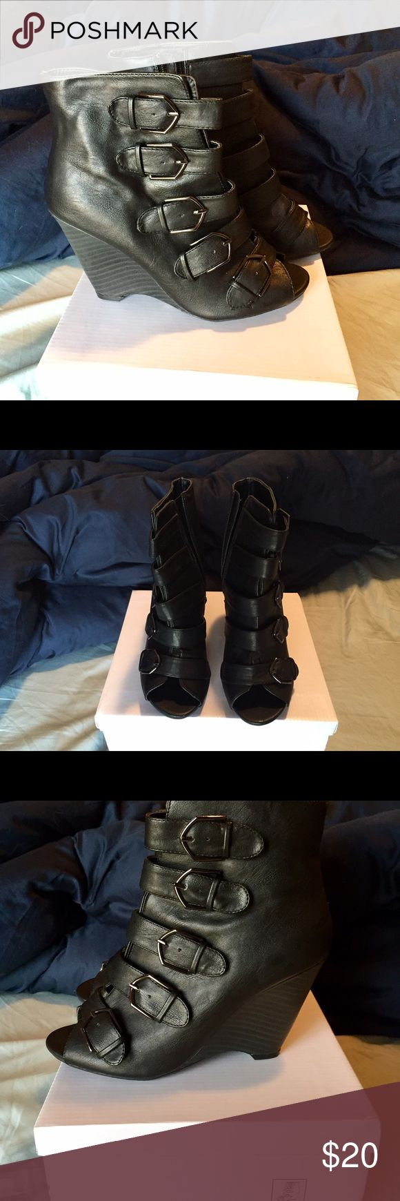 Black wedge ankle boot Black, peep toe, wedge with side zipper. Never been worn! Black Poppy Shoes Ankle Boots & Booties