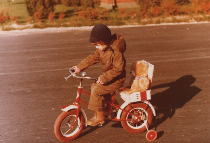 """#Reima70 In fall 1980 I was 3,5 years old and waiting for my little brothers birth, so I gave a ride to my teddy bear called """"Sekko"""". My dad build him his own safety seat of cardboard so teddy bear could come along to my bike rides. -Niina"""
