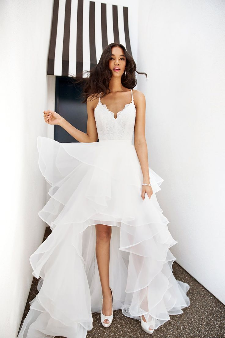 How to wear a sexy wedding dress even Grandma will love. Tips for brides who prefer sexy wedding dresses over traditional. | Photo by This Modern Romance for 100 Layer Cake