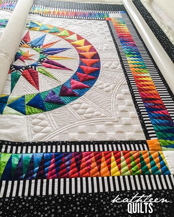This afternoon. Rockys been away this weekend so it's just been me and my Lucey. Quilting like crazy :) Pieced by Joan. Pattern by @becolourfulquilts . I was sooo excited to get to quilt this one :) #apqslucey #apqscanada #becolourfulquilts