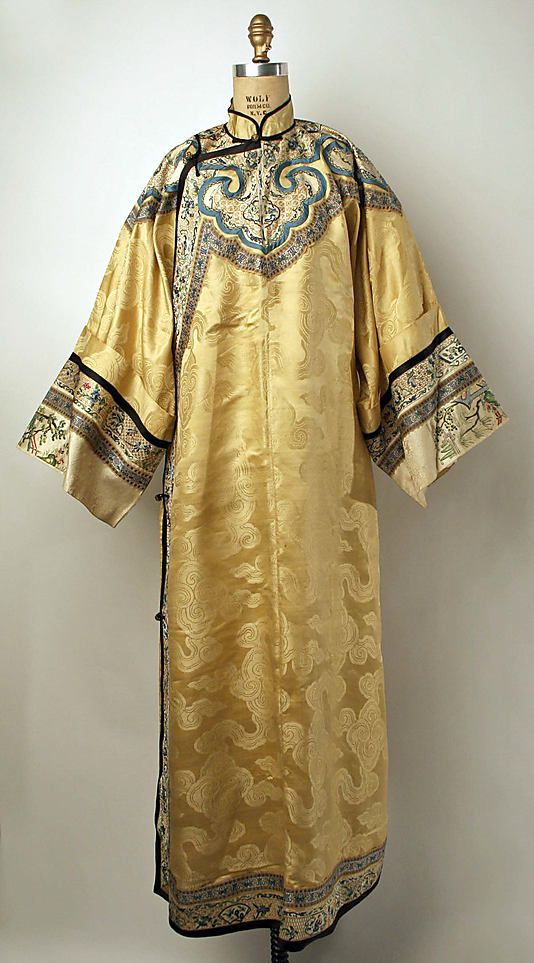 20th century Chinese Qipao // Medium: Light yellow silk, metal // Dimensions: Length: 59 1/2 in. (151.1 cm) // Credit Line: Gift of Mr. Alan L. Wolfe, 1961 // Accession Number: C.I.61.15.2