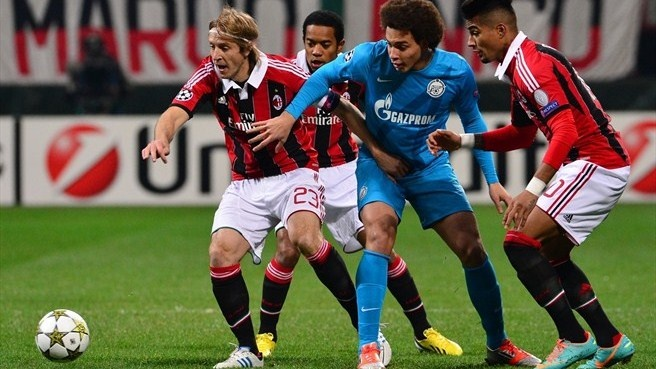 FC Zenit St Petersburg's Axel Witsel (C) fights for the ball with Massimo Ambrosini (L) of AC Milan during their UEFA Champions League group stage match  ©AFP/Getty Images