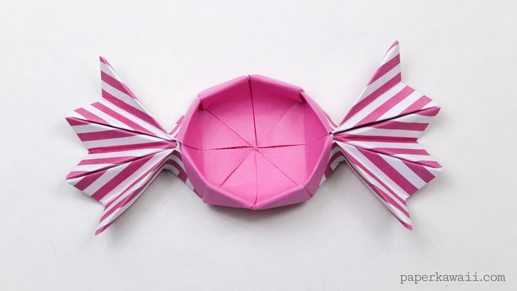 With this tutorial you can learn how to make a round origami candy box, this time the 'fans' of the candy are pointy, or you can leave them straight.