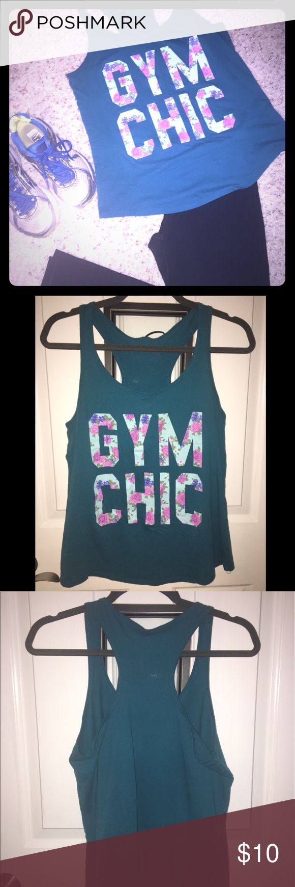 "Razorback tank top Dark teal blue ""Gym Chic"" razorback tank top with floral design. Look super cute and feel amazing 💁🏼 Worn a handful of times and well taken care of, no visible damage to shirt or design. No tag found 🤔 but fits the same as a M tank top of the same design. Tops Tank Tops"