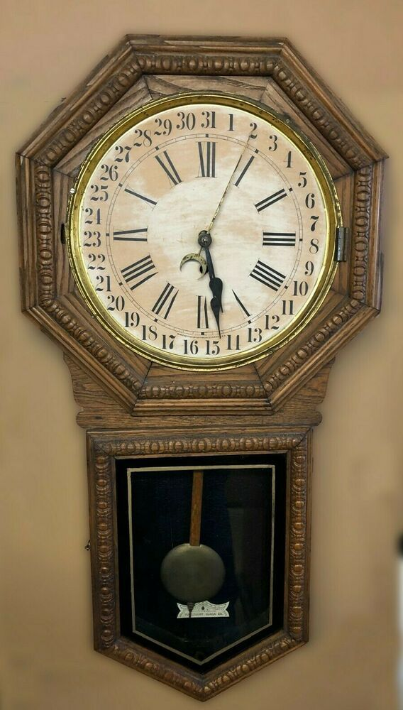 Antique Waterbury Oak Octagonal Calendar Wall Clock