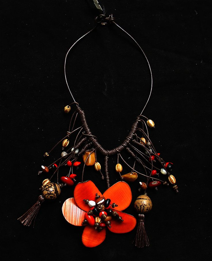 This necklace is part of the Orinoco collection which is based on the indigenous people of the Orinoco river in Venezuela. #necklace #ethnic #fashion #flowers #seeds #orinoco #indigenous #accessories #fashionforward #fashiondesign #unique #venezuela #colombia #timelessfashion #tribal