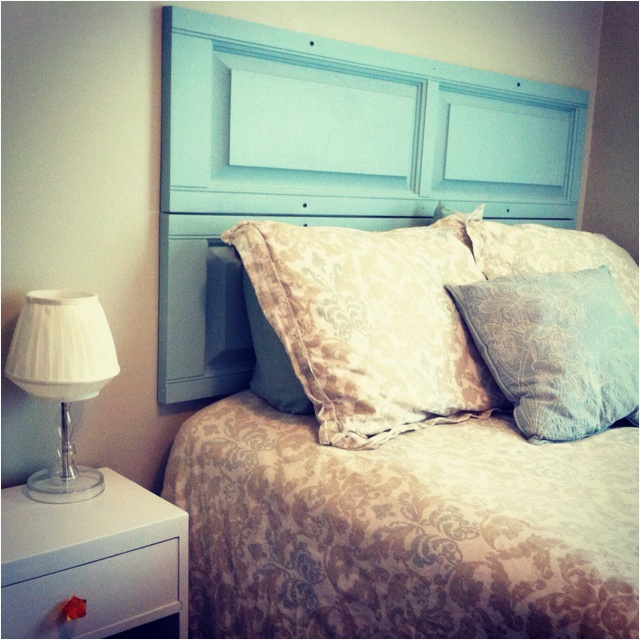 My $2 headboard! Found some plastic shudders at the Habitat for Humanity Home Store for $1 each and painted them with leftover paint from the master bedroom!