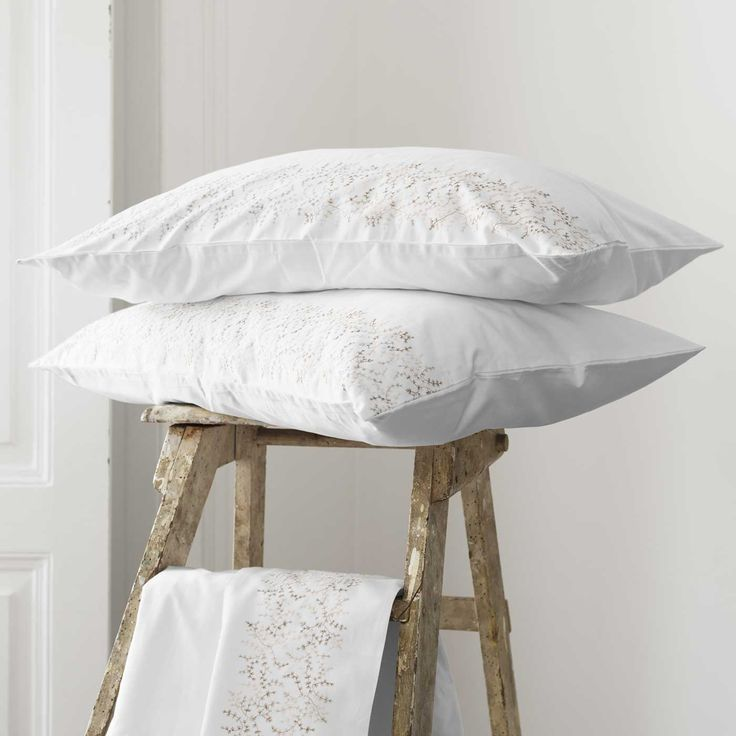 Kelly pillowcases feature a delicate fawn and beige flower motif.