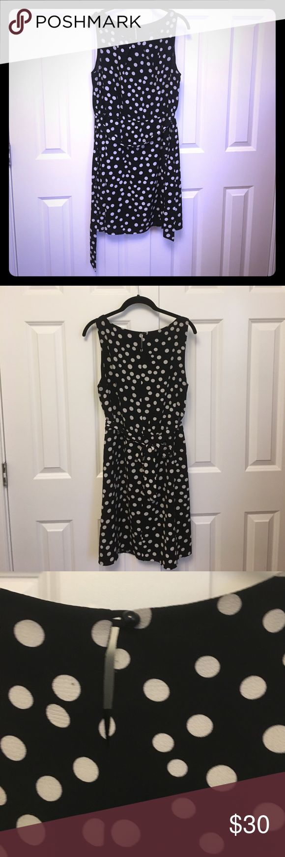 Black and white polka dot dress Beautiful black and white polka dot dress by Jacob. Dress is classy yet fun. Has belt that can tie in front or back. Elastic band at waist. So cute on and can be dressed up for work or down for a weekend. Polka dots are not bright white- more cream colored. Small slit and button on back.  Made in Canada Jacob Dresses Midi