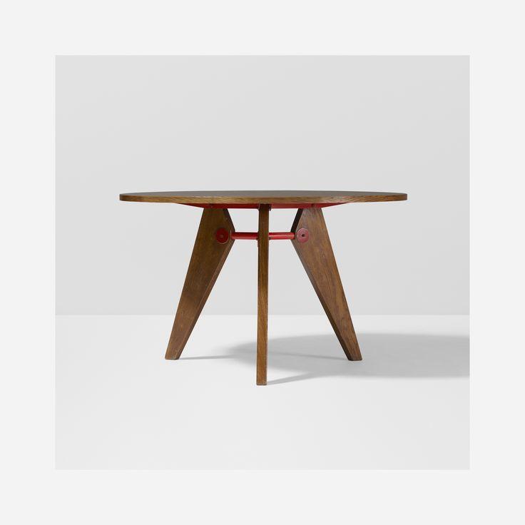 Lot 109: Jean  Prouvé. Guéridon, model 401. 1949, oak, enameled steel. 44¾ dia x 27½ h in. result: $55,000. estimate: $20,000–30,000. Provenance: Michael Benevento, New York | Collection of Dimitri Levas