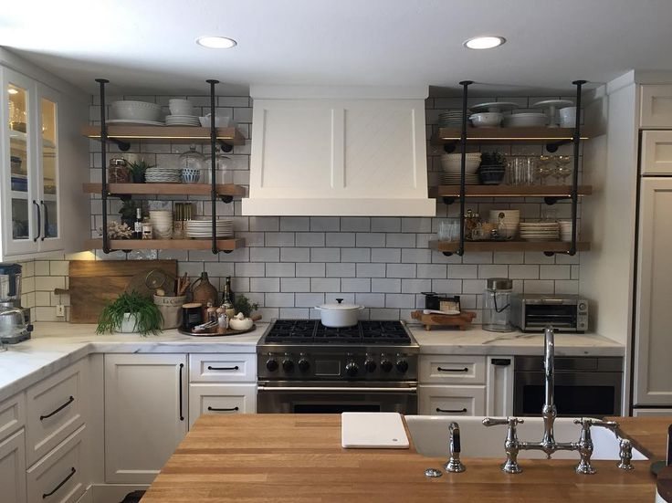 Here's the kitchen ❤️ we wanted it to look collected and lived-in but not too industrial.  #kitchendesign #kitchen #kitchenstorage #organizedlife #organizedhome #organized #kitchendecor #kitchenremodel #kitcheninspiration #kitcheninspo #kitchenaid #kitchensink #kitchenstuff #homeremodel #bohochic #french #bungalowstyle #bungalowaz