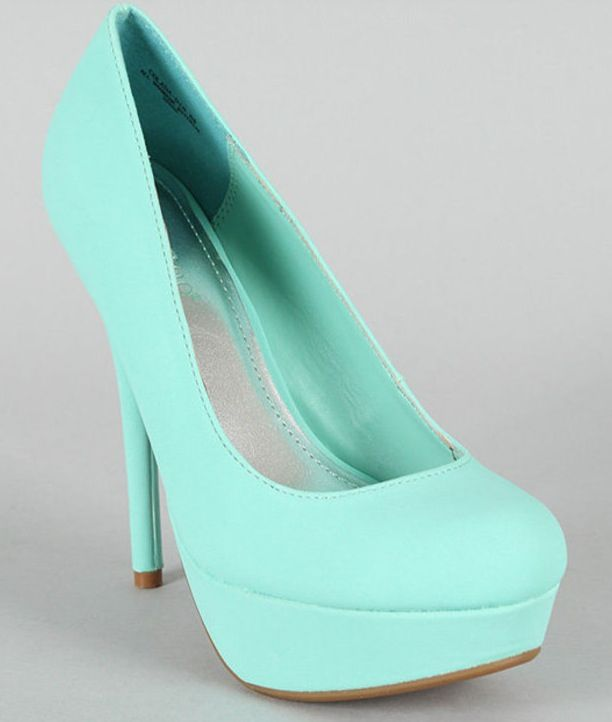 Teal high heals that are gorgeous.
