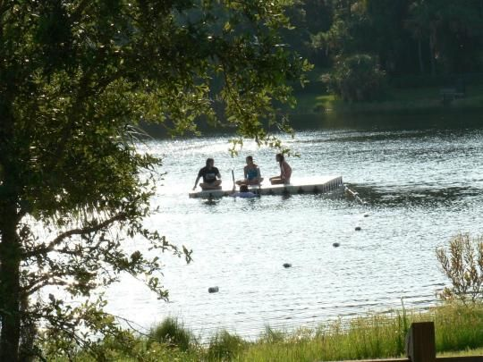 Children relax while swimming in Lake Osprey. | State ...