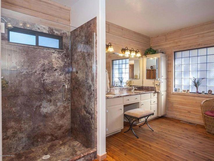 Rustic Master Bathroom With Frameless Showerdoor Hardwood
