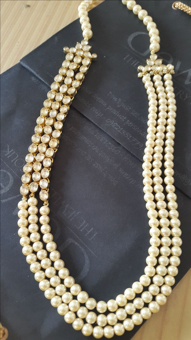 "Long Kundan and Golden Pearl Necklace. Exclusively Designed for the ""Royal Lady"" For queries inbox us on ""gewelsdesign@gmail.com"" #jewellery#jewel#fesigner#fashion#womennecklace#pearl#kundan#long#charing#brand#classy#gewels#."