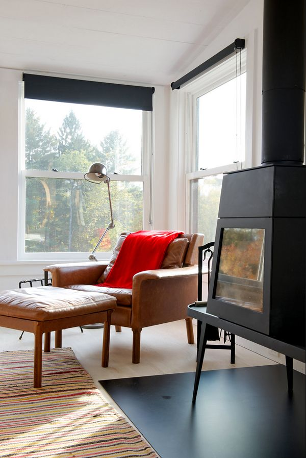 A  renovated midcentury bungalow in NY with  modern wood burning stove #fireplace