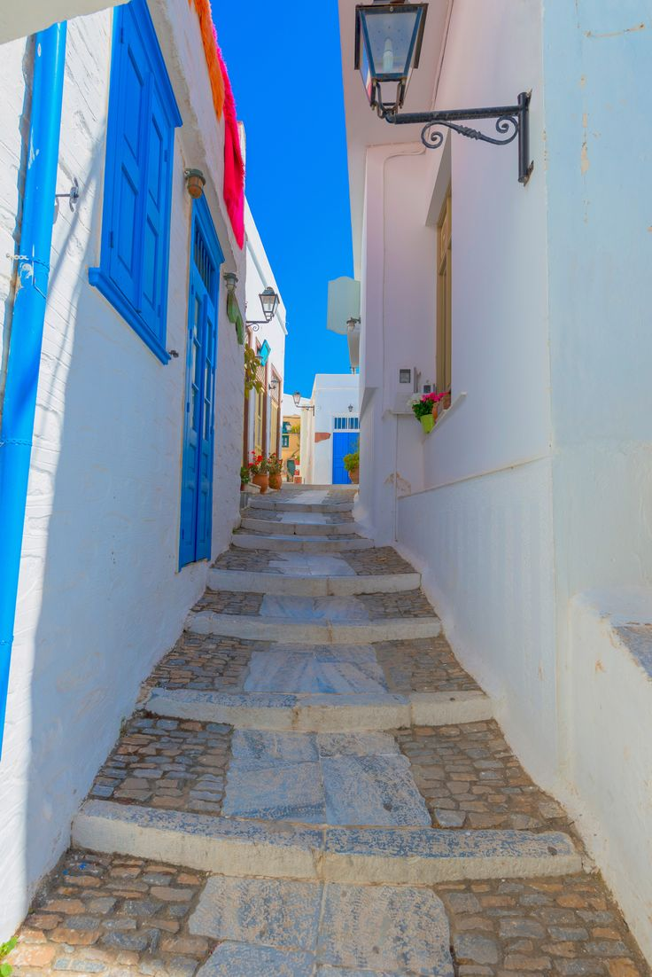 Narrow street on Syros island in Greece.
