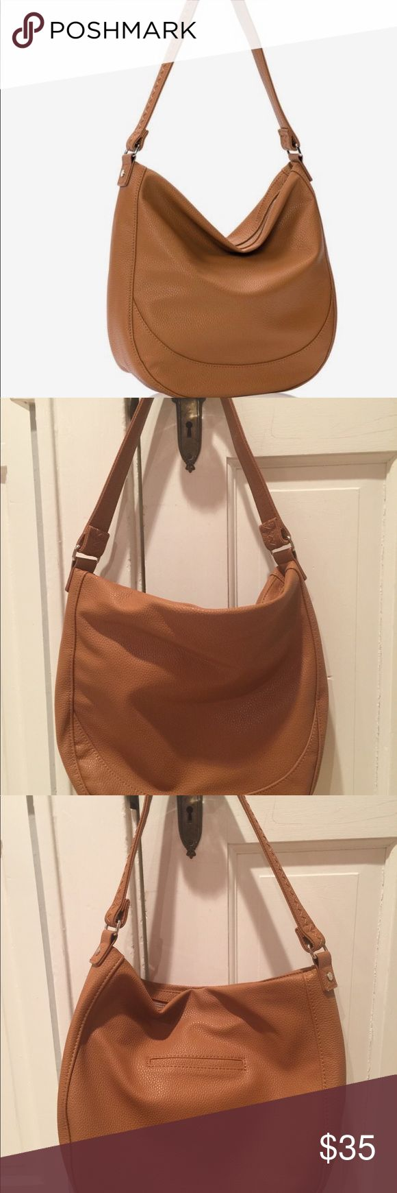 """Thirty-One Mini Hobo Bag in Caramel ❤️ Stylish and slouchy ❤️ Midway Hobo bag is the perfect everyday bag you can take to the office or out for a night on the town. Only carried two times and in excellent condition. zipper closure, 3 interior pockets and a hidden exterior cell phone pocket.  Pebble Faux Leather Poly Satin Lining Interior zipper pocket and 2 interior flat pockets Hidden exterior cell phone pocket Zig-zag stitch detail on handle Approx. 12.5""""H x 12""""L x 3.5""""D Bags Hobos"""