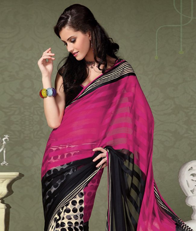 """If you are a true fashion cultivator of ethnic desires, this vogue collection of sarees from """"Panash"""" will help you to justify the needs of your insatiable soul. Perfectly accentuating your feminine grace with ease, this range liberates the aesthetics of Indian tradition through the diversified designs in grace and sophistication. Unleash your shopaholic attitude through this collection with fashionandyou.com.Design Highlights: Polka Dot & Stripes Georgette Saree. BRAND: PanashCATEGORY…"""
