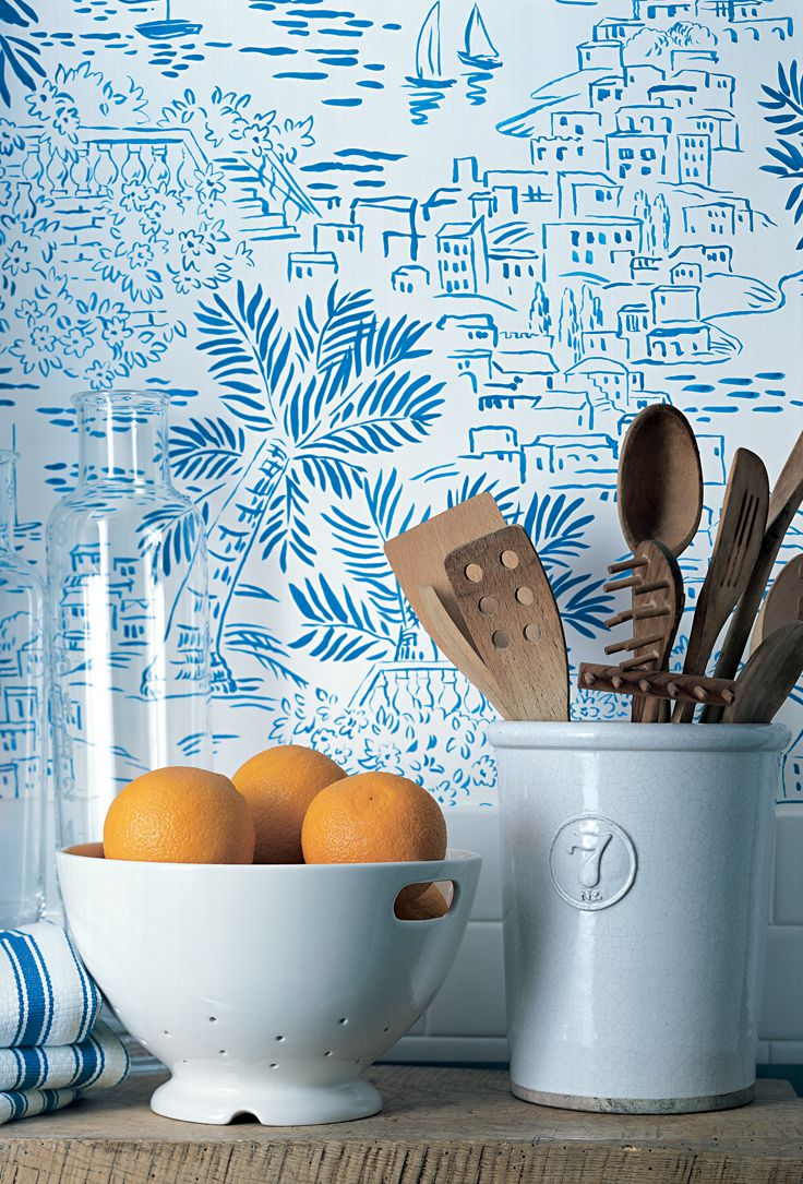 Painterly blue and white kitchen wallcovering depicts a seaside village, from Ralph Lauren Home