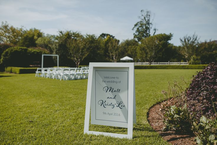 White + navy wedding welcome sign