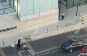 Farhad Jabar Khalil Mohammad (lower left) wields a firearm in gun-free Sydney, Australia. (Image: Channel 7 News, Sydney)
