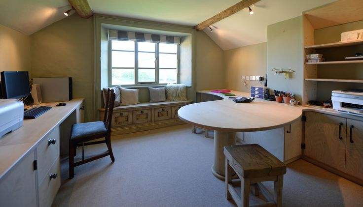 Here's another view of the study, this time showing the lovely bleached oak window seat and stools and the curved Birch Ply desk and cabinets.