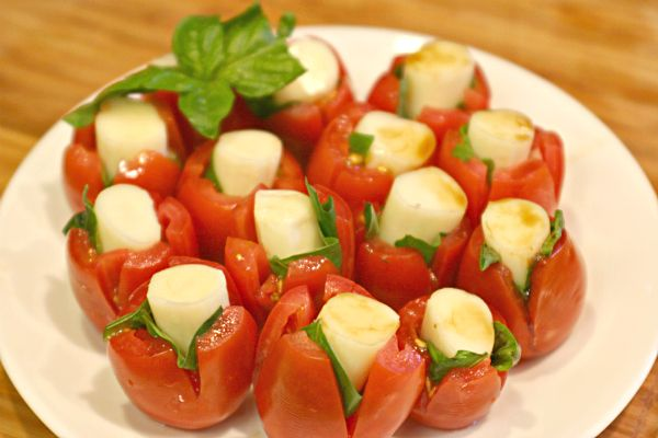 caprese bites using Kraft String Cheese -- may need to do this with the over-abundance of cherry tomatoes and basil in my garden.