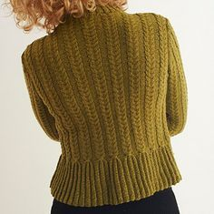 This stylish 4-ply cardigan features a cabled peplum. This richly textured garment is sure to add interest to any outfit.