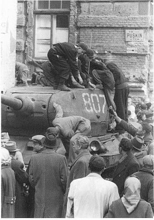 Hungarian soldiers inspecting a T-34/85 medium tank during the 1956 Revolution, Budapest, Hungary, Oct 1956