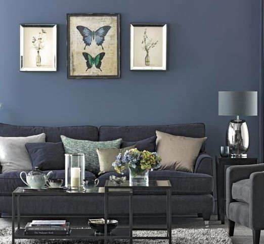 Beautiful room with a lovely muted but bold blue and grey/silver touches.