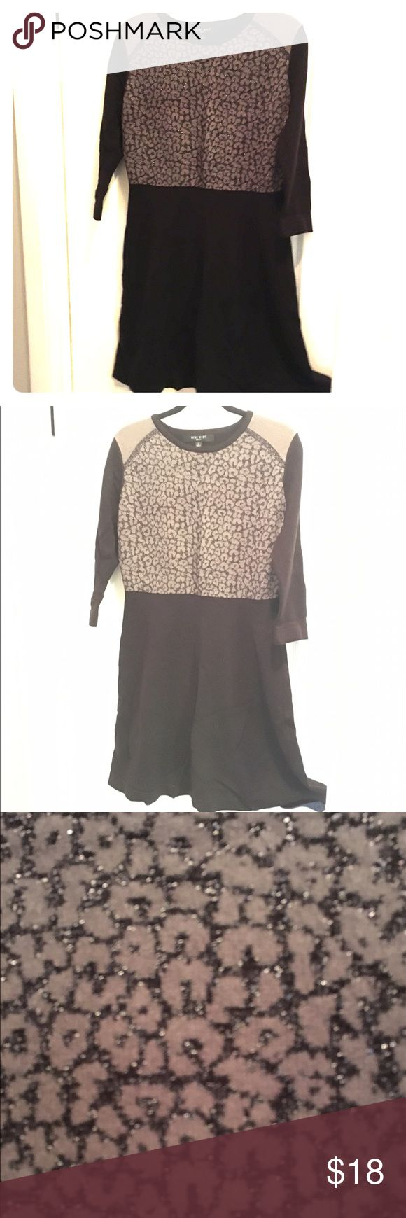 Animal Print Sweater Dress Animal print top with a flared skirt. Top is woven with sparkly silver threads- great for parties or work! Nine West Dresses Long Sleeve