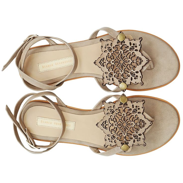 Flat sandals inspired by Persian culture. Made from natural leather. Decorated…