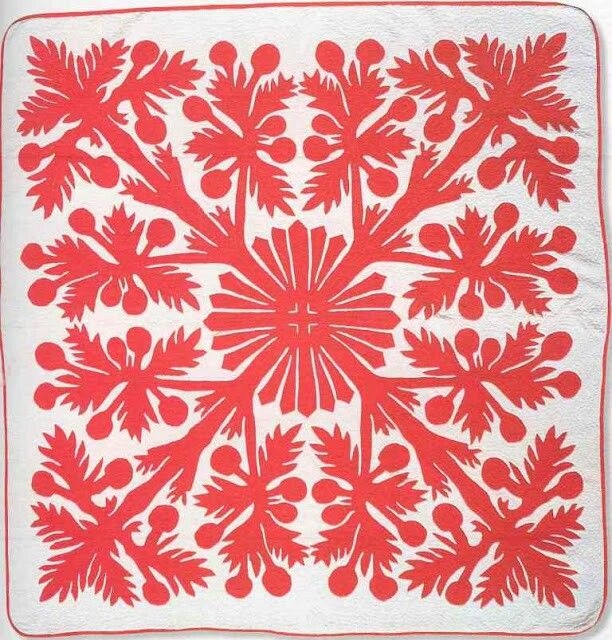 red on white Hawaiian style quilt
